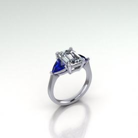 14kt white gold three-stone style ring with blue sapphire trillion side stones and an emerald cut diamond center stone.