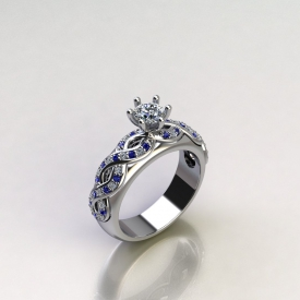 14kt white gold engagement ring with a round brilliant cut center diamond and a woven pattern on the sides with alternating round brilliant cut diamonds and blue sapphires.