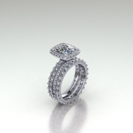 18kt white gold cushion shaped diamond with a halo of prong set diamonds surrounding the center and going down the sides of the ring.