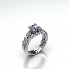 14kt white gold wedding set with a round brilliant cut diamonds diamond and round brilliant cut diamonds set down the side in marquise and round shapes. The wedding band is a contour band with round brilliant cut diamonds set across the stop. Both rings have a beading finish.