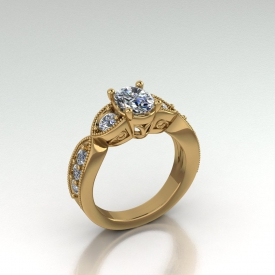 14kt yellow gold antique style diamond ring with an oval cut diamond center stone and round brilliant cut side stones, there is a beading finish and scroll work on the face of the ring.