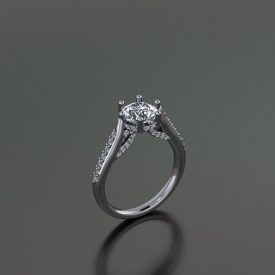 14kt white gold engagement ring with bead set round brilliant cut diamonds down either side and a halo under the center diamond with scroll work under the halo that has prong set diamonds set throughout.