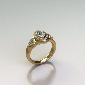 14kt yellow gold ring that has a bezel set marquise shaped diamond in the center and a halo with round brilliant cut diamonds surrounding it, and two pear shaped diamonds on either side that are bezel set.