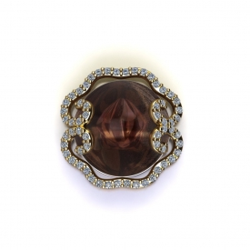 14kt yellow gold fashion pendant with a round rustic sapphire center and a halo of round brilliant cut diamonds.