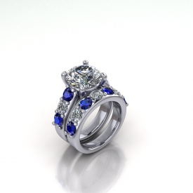 14kt white gold wedding set with alternating blue sapphires and white diamonds, there is a round brilliant cut center diamond.