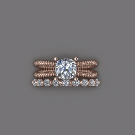 14kt rose gold wedding set that has a solitaire style engagement ring with a twisted-cable shank, and a wedding band that has shared prong-set round brilliant cut diamonds across the top.