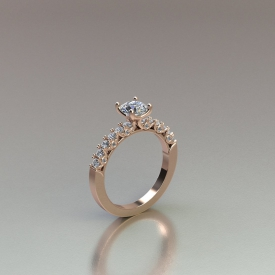 14kt rose gold engagement ring that has a round brilliant cut center diamond, diamonds going down either side that are shared-prong set, and bezel set accent diamonds on either side of the ring between the sides diamonds.